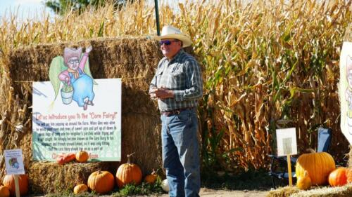 """Rex Larsen telling the history of the """"Corn Fairy"""" to visitors."""